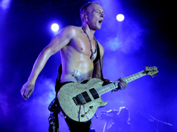 "LOS ANGELES, CA - JUNE 08:  Musician Phill Collen of Def Leppard performs at the after party for the premiere of Warner Bros. Pictures' ""Rock Of Ages"" at Hollywood and Highland on June 8, 2012 in Los Angeles, California.  (Photo by Kevin Winter/Getty Images)"